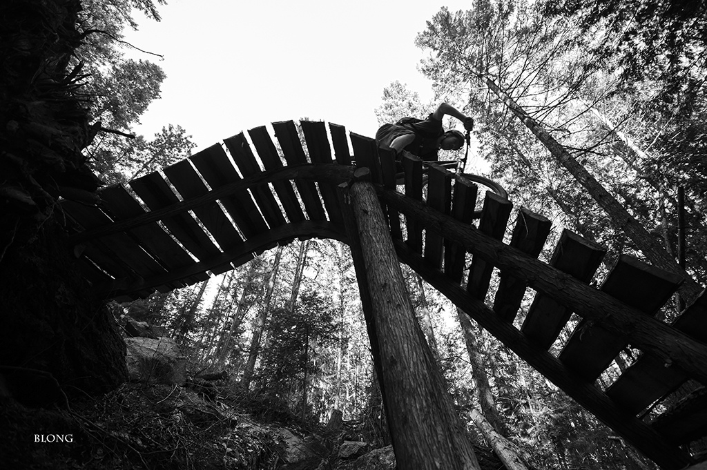 Bruno Long goes black and white for cedar against sky. Riley flows some Kootenay bridgework on a trail he has enjoyed over and over for years.