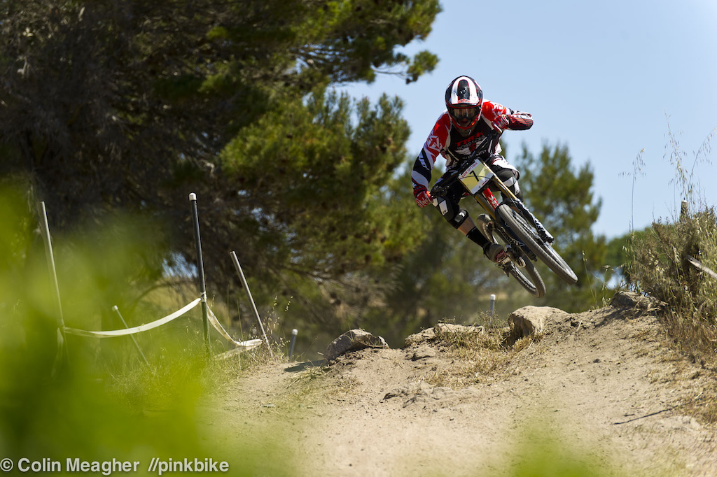 Rookie Trek World Racing rider Greg Williamson keeping it low in on the only rock feature on the track.