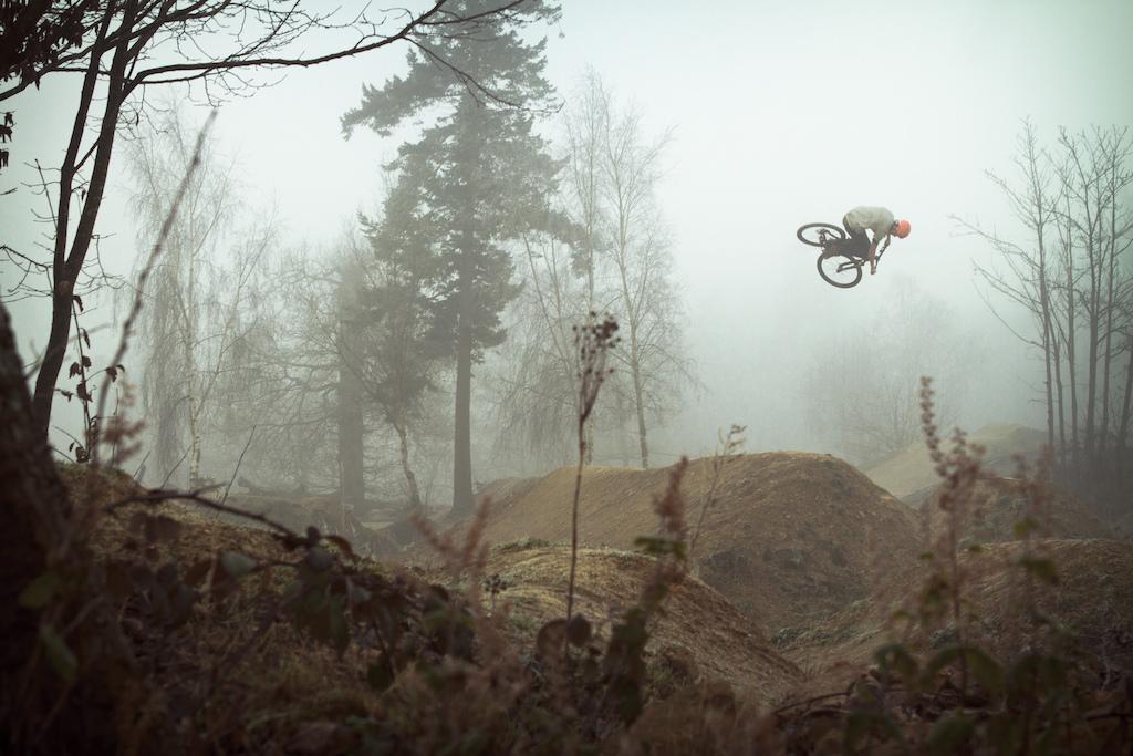 Twists through the fog.
