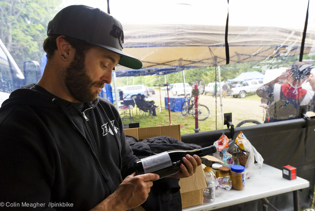 Mechanic appreciation day--Justin Frey of Fox Racing Shox checking over a tip left at the Fox Pit. It s nice to feel appreciated man.