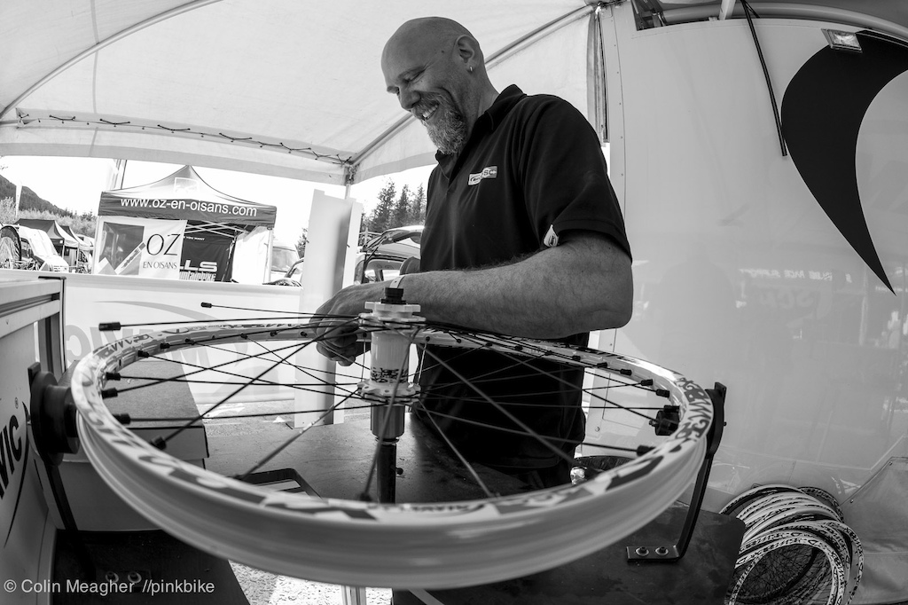 Ian Hopwood knocking out a hurry up wheel build to replace a completely trashed hoop.
