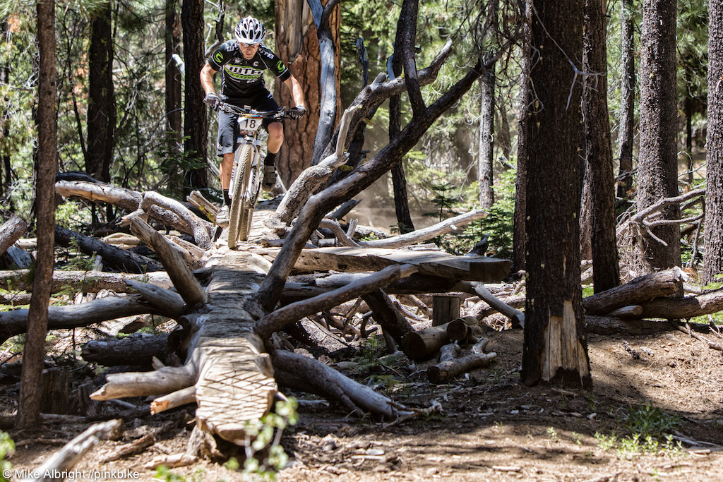 WTB s Jason Moeschler riding the fallen tree that was made into a log ride. There is a go-around but this direction will save some seconds if you make it clean.