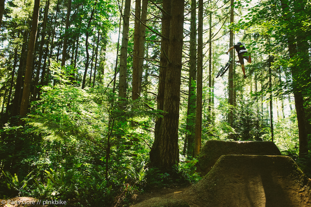Steven Bafus tail whipping the massive step up at the Jungle Trails. Photos do no justice on how big this jump is.