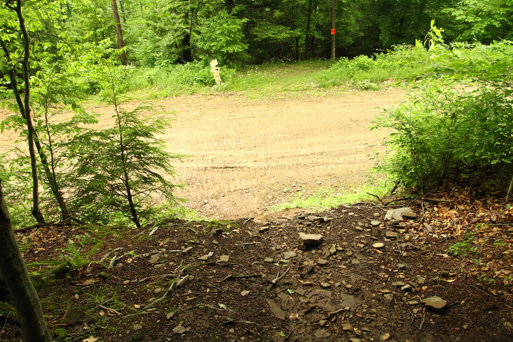Dropping into the fire road.  Come practice, there will also be a berm added to the bottom to let riders carry more speed into the fire road.