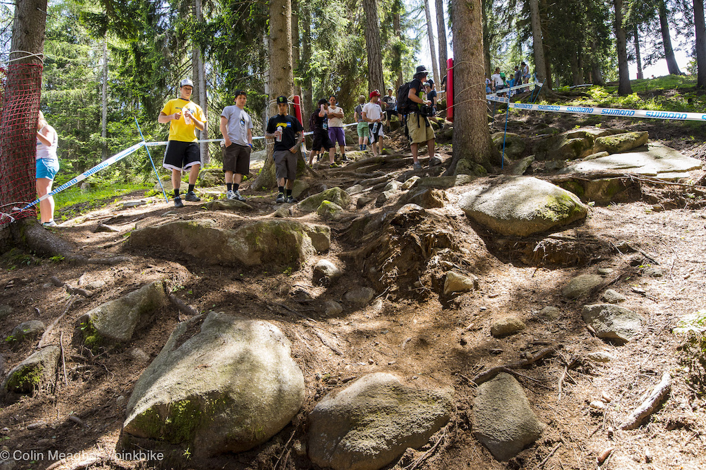 Val di Sole is imfamous for the rock garden in the first woods. It s traditionally been a 10 meter wide affair but this year it s been taped a bit tigther so there s a definite line.