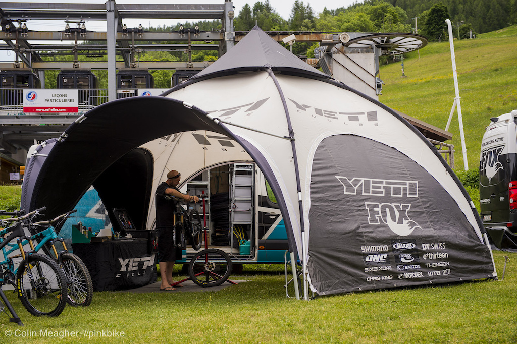 Shaun Hughes prepping bikes in the Yeti pop up tent. & at Enduro Track in Val D Allos France - photo by meagerdude ...