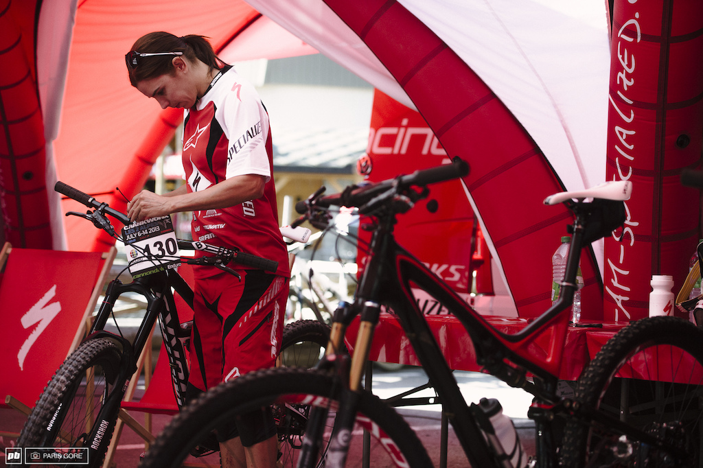 Anneke Beerten putting on the last touches to her bike before a full day of practice.