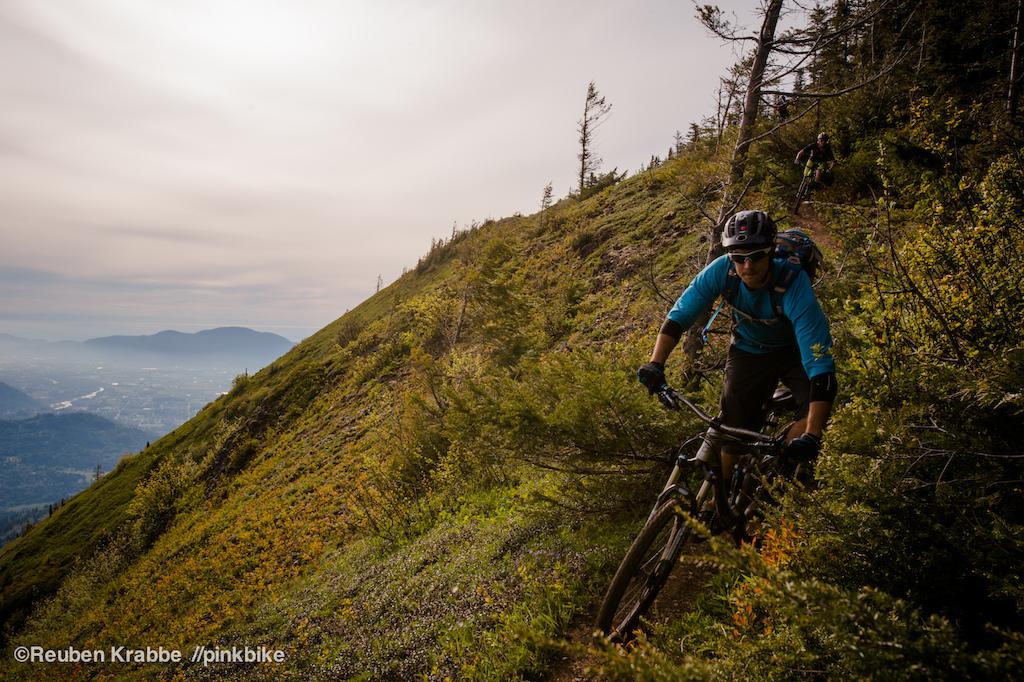 Stephen Matthews hugs into tight singletrack on the edge of Elk Mountain