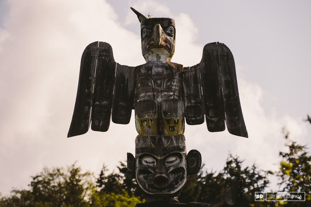 The totems on Alert Bay are the real deal. Carved from real wood by real natives a long time ago.