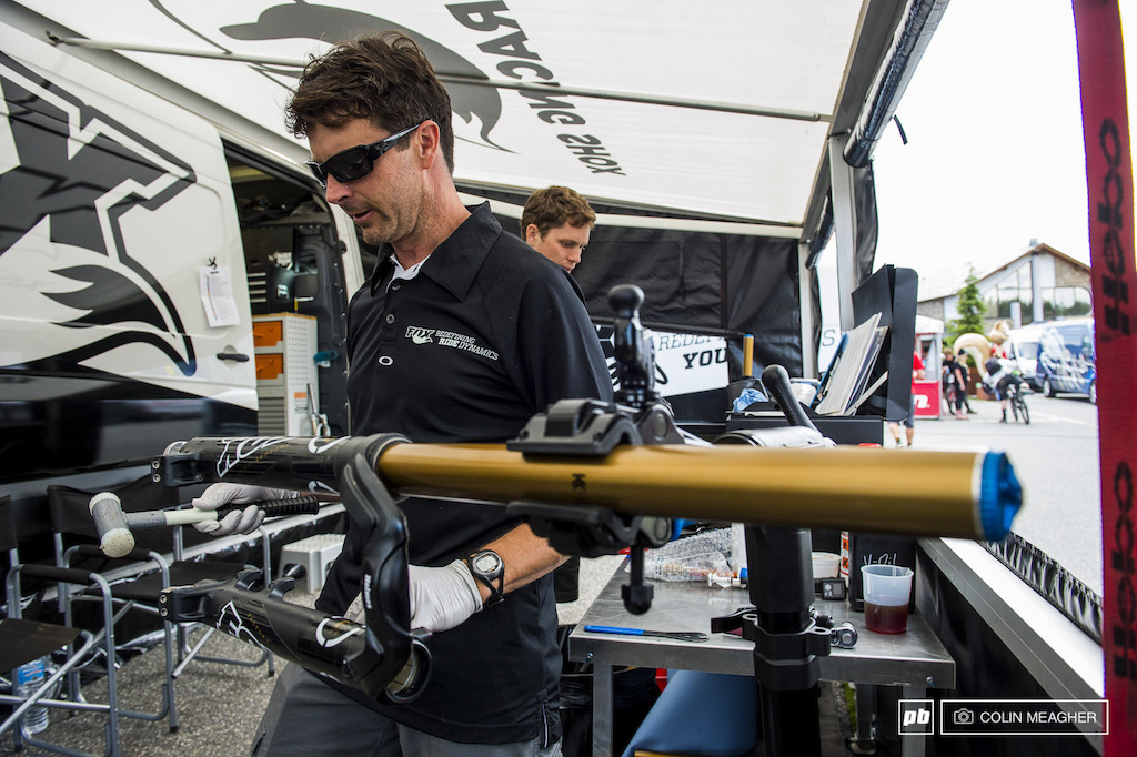 Mark Fitzsimmons putting the mechanic s favorite tool--a hammer any kind of hammer--to work in the Fox Racing Shox pits after the day s practice.