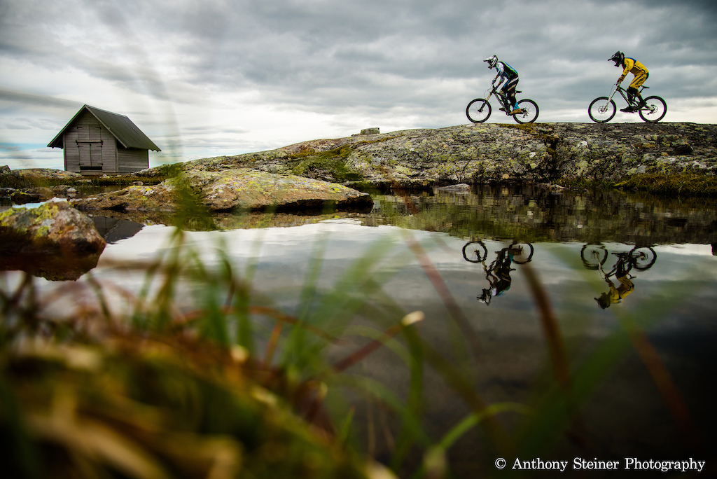 The reflection of the riders in a small pond on the heights of Åre in Sweden.