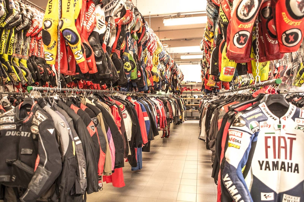 THE ARCHIVE. this room with a distinctive smell mixture of lether oil sweat and race history contains all the pieces that Dainese made for their Pilots since day one.