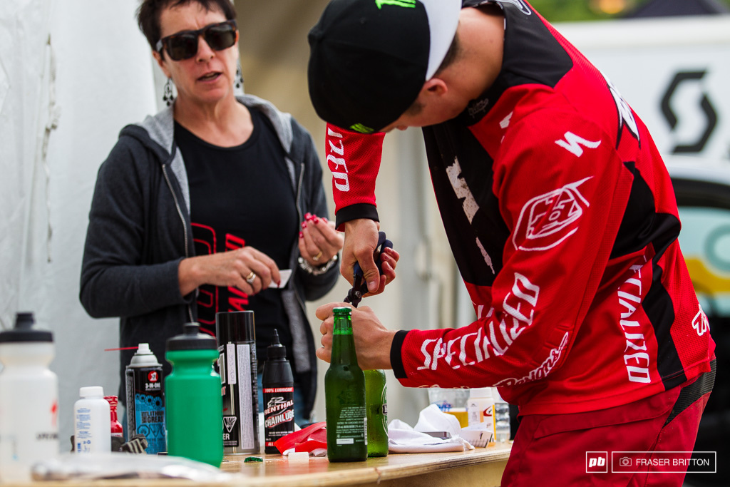 Troy Brosnan tries to crack into some beers for mom and dad who came out to watch the race all the way from Australia. Unfortunately the young ripper isn t quite adept at it yet and managed to take the entire top off of the bottle instead.