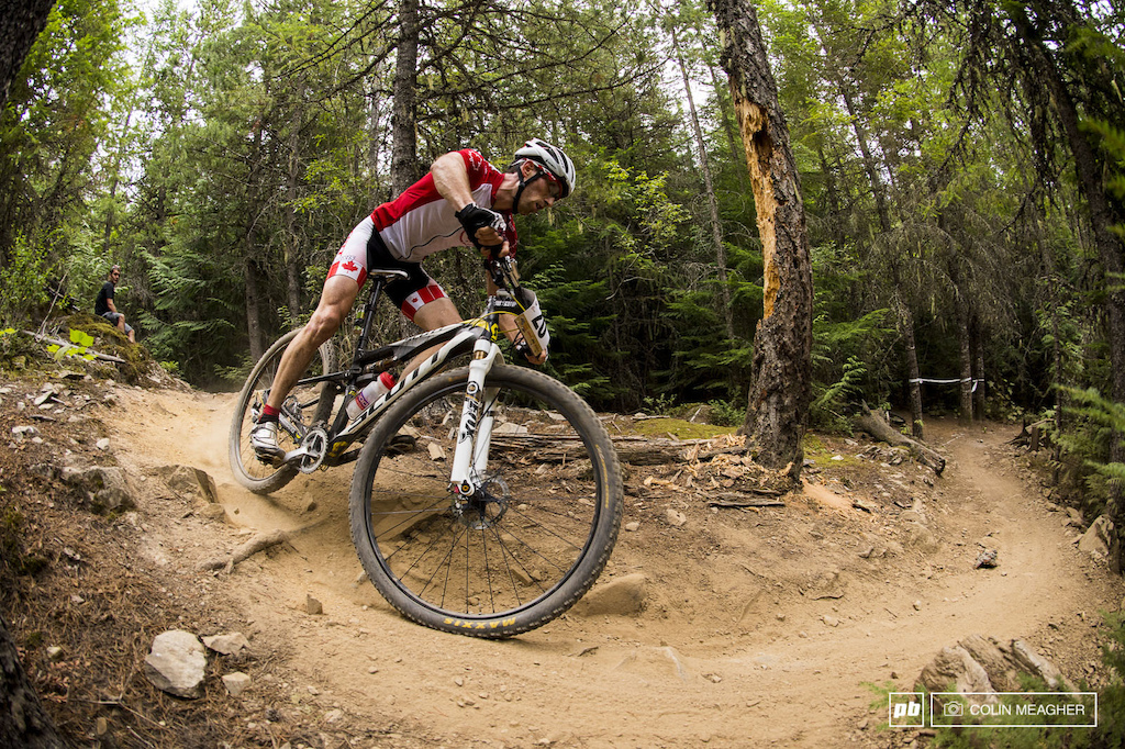 Derek Zandstra getting diving into the descent during the 5 lap Canadian Open XC race out on the Lost Lakes Trails.