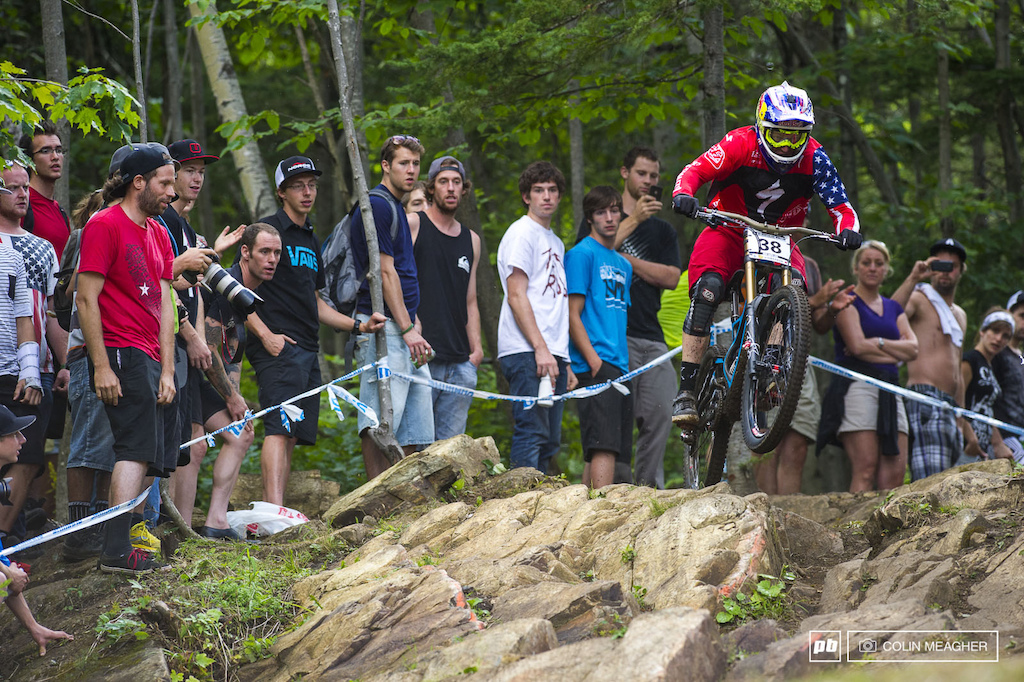 Racing for the win at the 2013 UCI MTB World Cup DH race held at Mt St Anne in Quebec