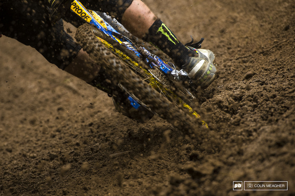Silent but deadly--Sam Hill slicing effortlessly through the roosty goodness of the first day of practice. Hill thrives on wet riding--or at least he s developed a reputation of reveling in it. The storm that soaked the top tier riders of the Men s Final though forced him to scavenge tear-offs from teammate Matthew Simmonds for his race run.