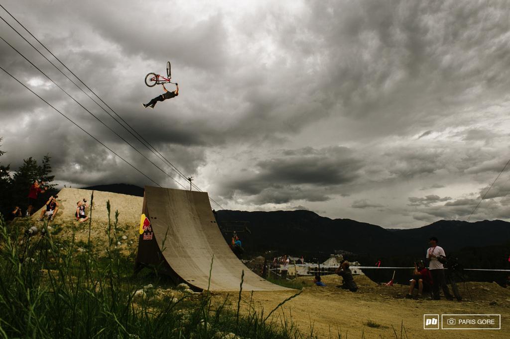 Yannick Granieri flip whip over the dark skies.