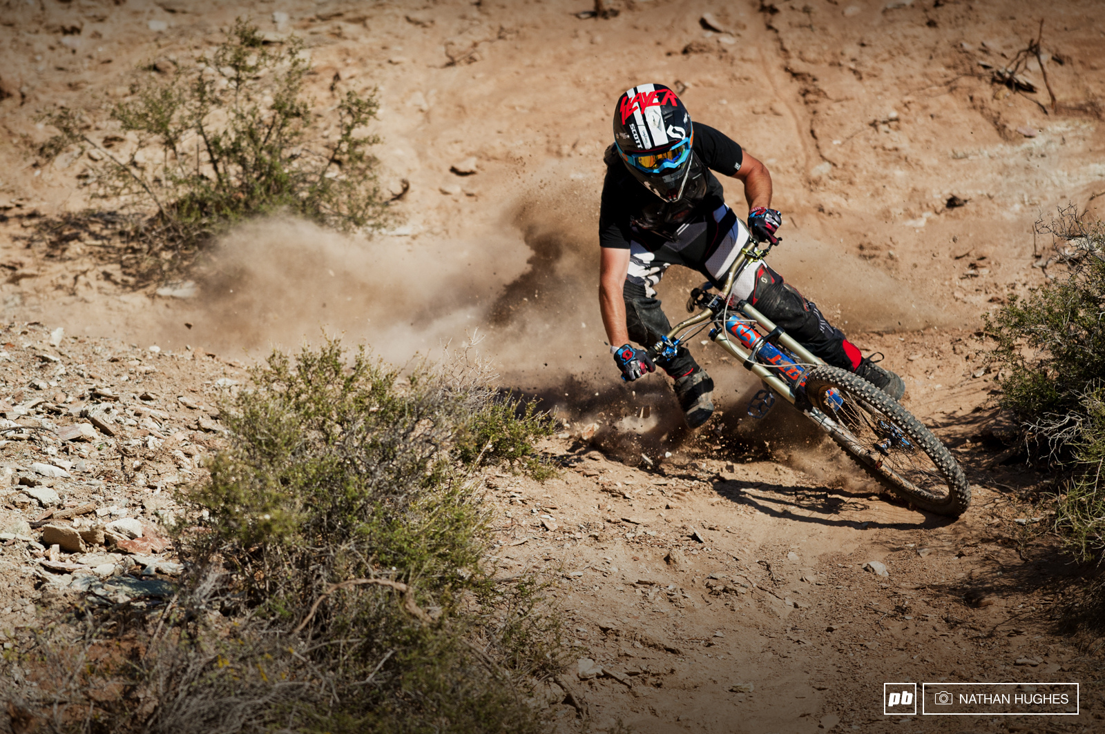 Nico Vink kicking up a fuss. He s hung up his downhill boots for a bit but had been plenty busy digging big things and shooting edits. No surprise he s at Rampage for a second time riding and crafting away with Lacondeguy.