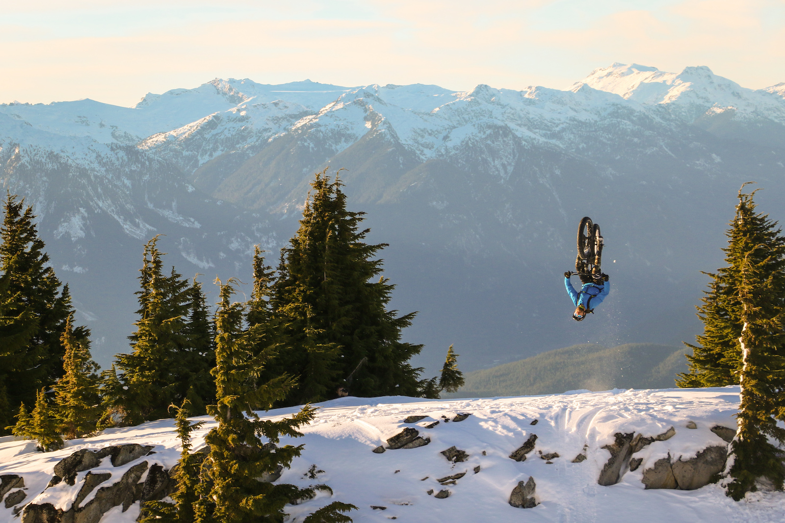We haven't seen an on-snow fat bike flip before, but we're most surprised that Gully can flip this straight.   Photo by Fraser Vaage.