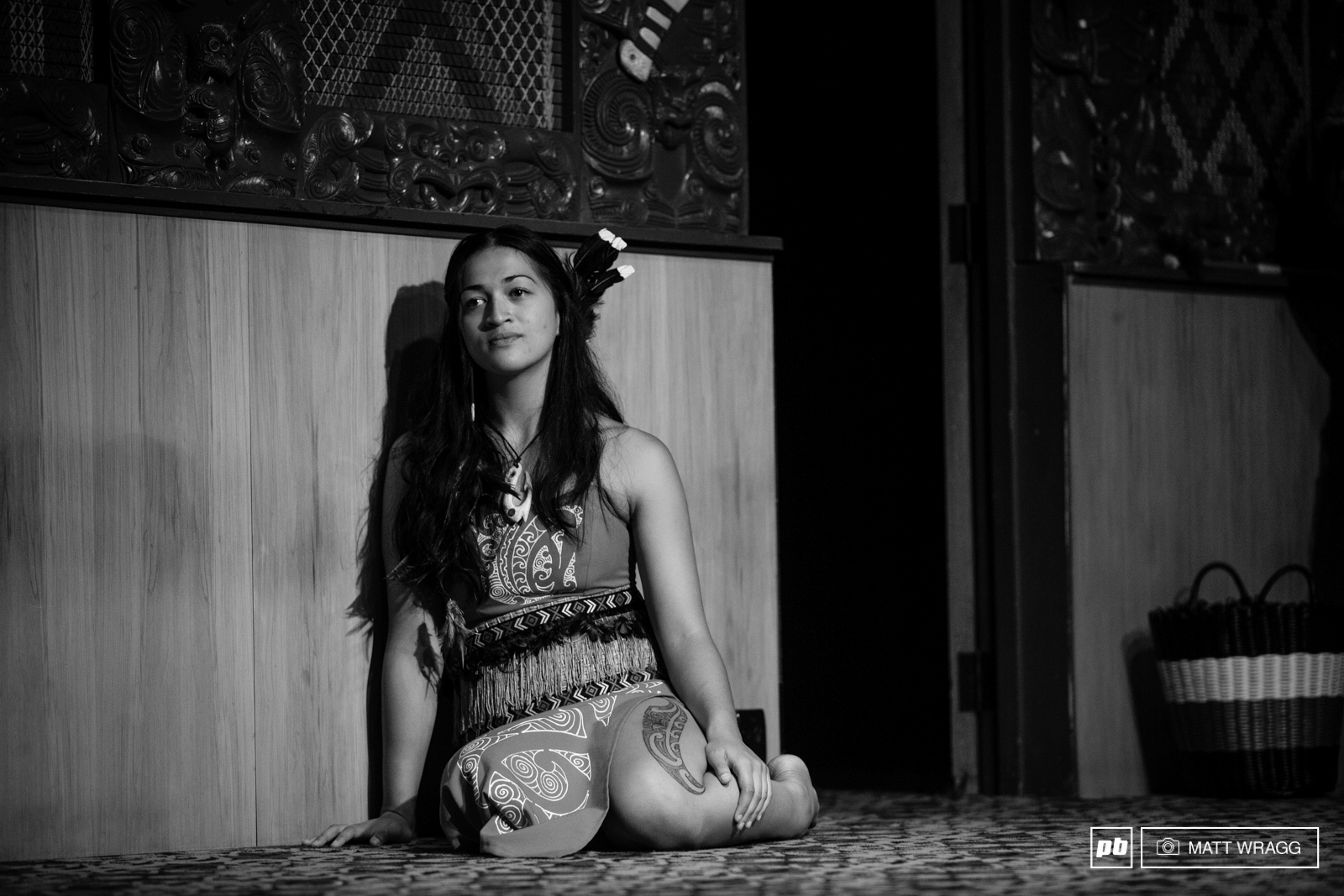 A performer rests between ats during opening ceremony at Te Puia. Maori dance during opening ceremony at Te Puia. EWS 1 2015 Rotorua New Zealand. Photo by Matt Wreagg.