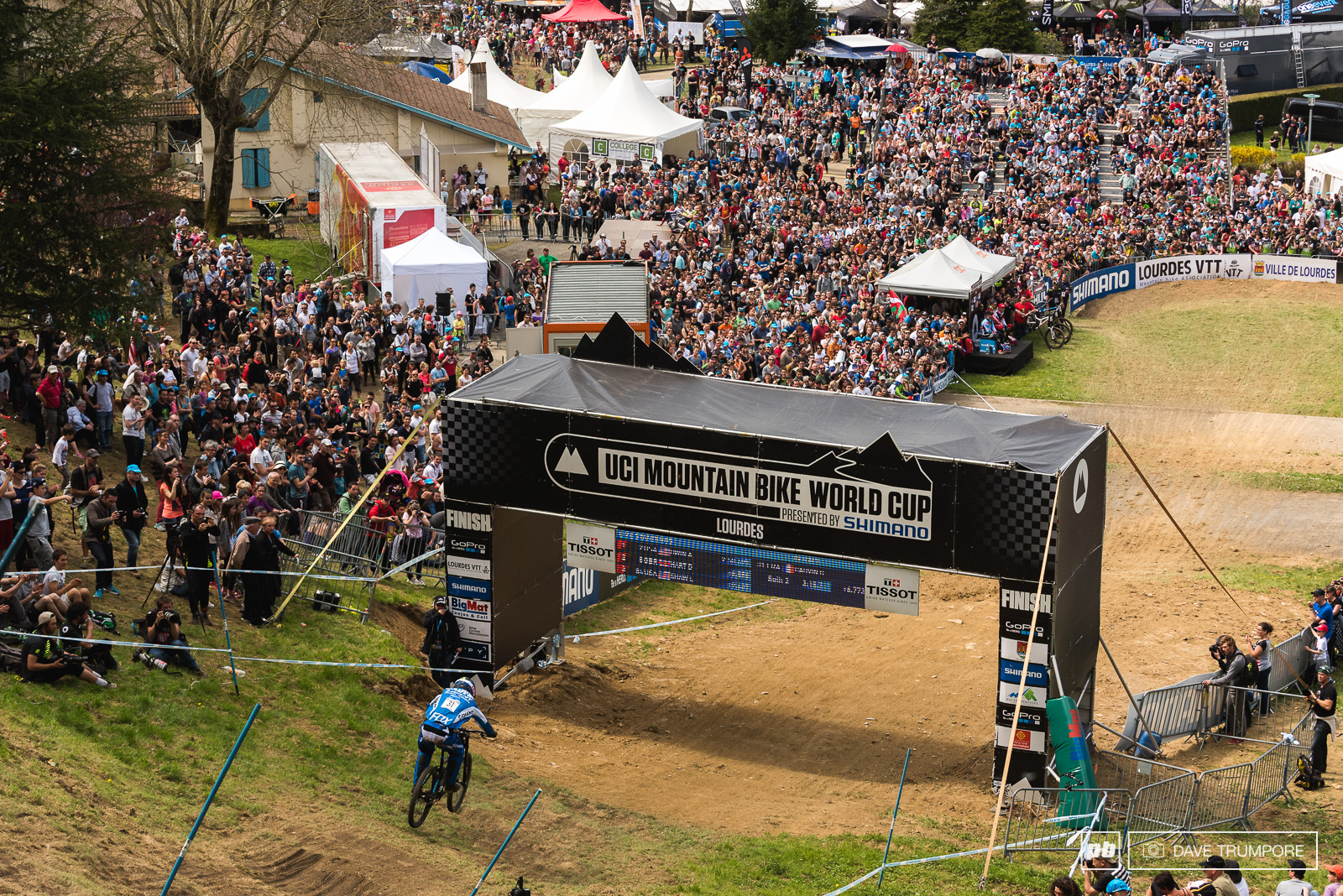 Guillaume Cauvin gets things started for the top 20 men as he drops into a capacity finish line crowd in Lourdes.