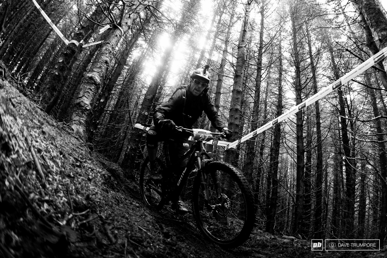 Francois Bailly-Maitre rolling the big wheels through the tight trees