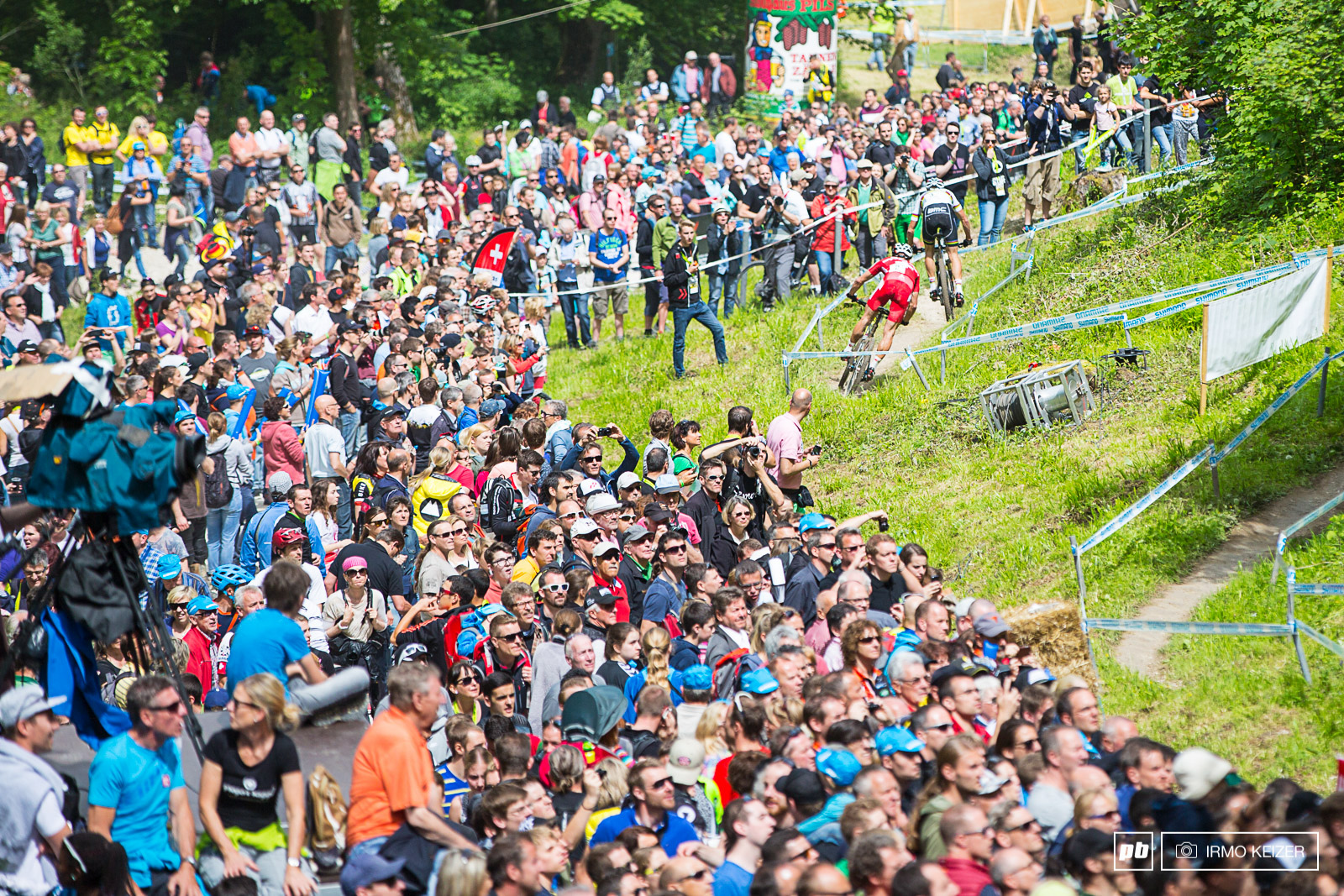Nino Schurter and Julien Absalon battled hard for victory. The course was packed with crowds roaring riders forward.