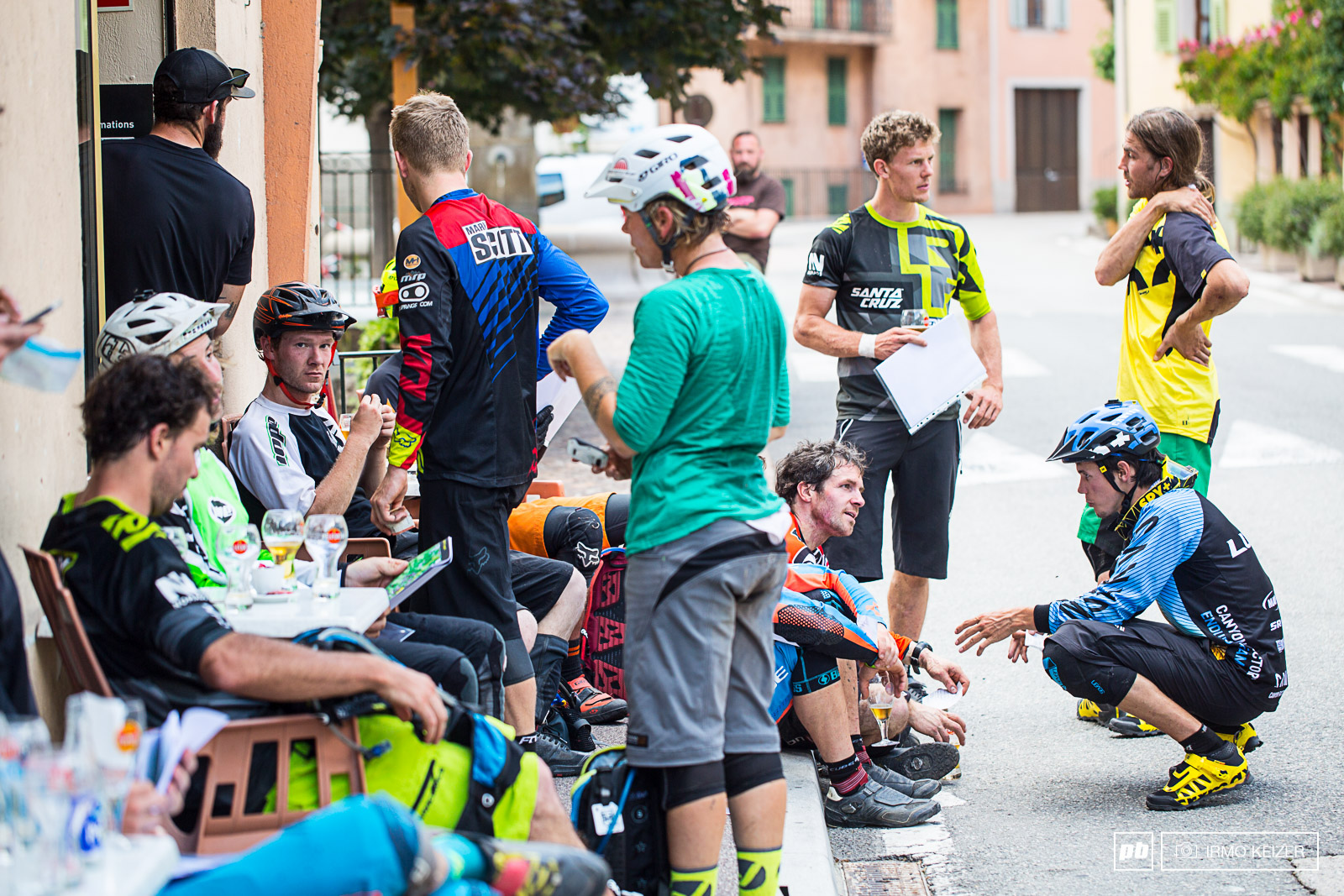 Riders await transfer to the camp high up in the mountains enjoying cold drinks and sharing stories.