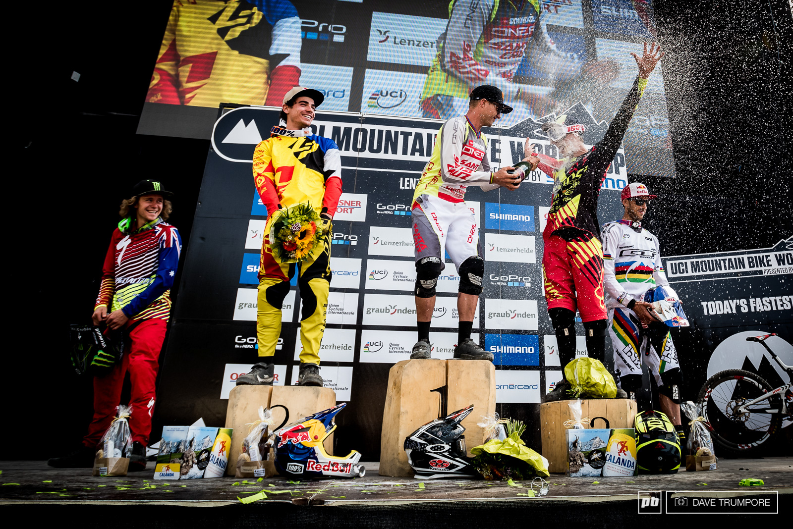 With a record breaking 18 World Cup wins and countless podium finishes Greg Minnaar knows the proper etiquette for welcoming a first timer onto the box. Drink up Dean Lucas
