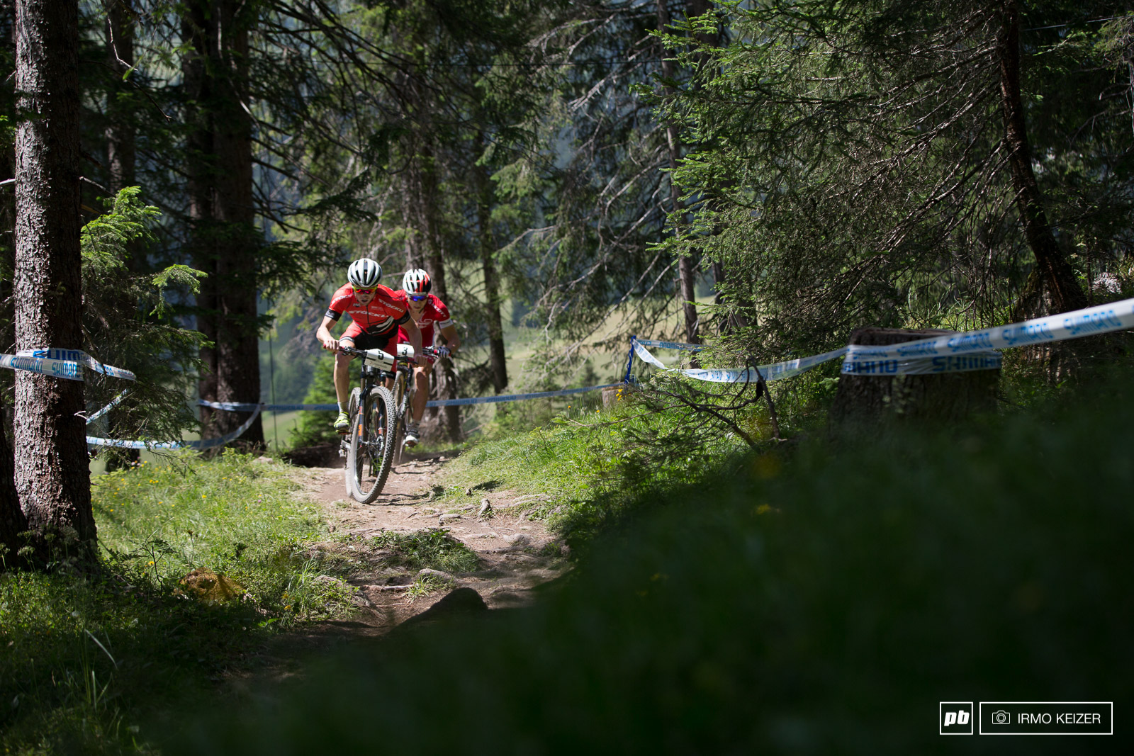 Matthias Flueckiger and Nino Schurter lead the first lap.