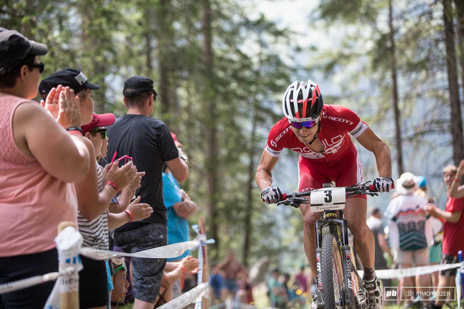 Roars screams shouts as crowds could not believe their eyes. A puncture had cost Schurter a mere twelve seconds but Kulhavy was gone.