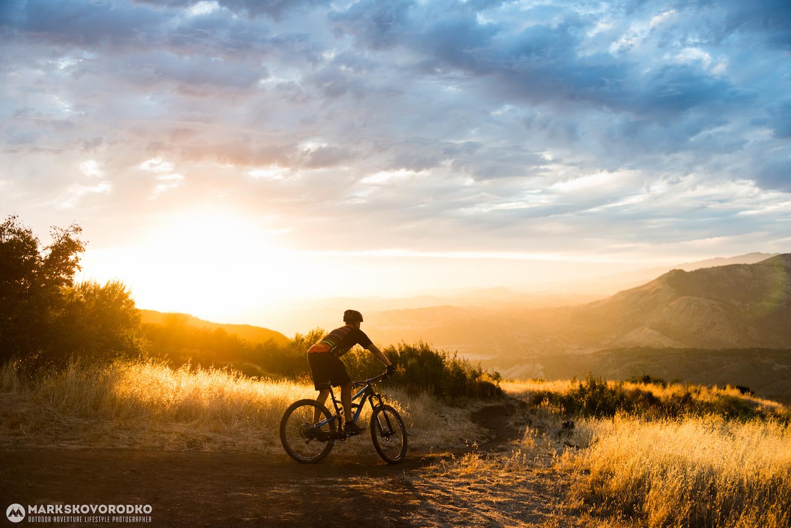 Filipp Kozachuk descends Snyder Trail a.k.a. Knapp s in the backcountry of Santa Barbara California as the sun sets over the Santa Ynez Valley.