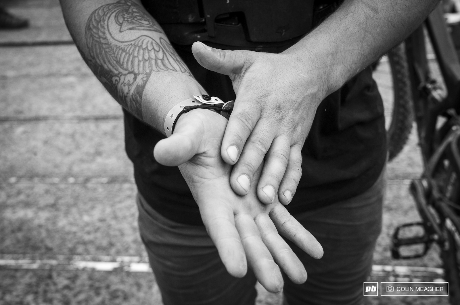 Yannick Granary chalking his hands with dust to help keep his hands from slipping on his grips.