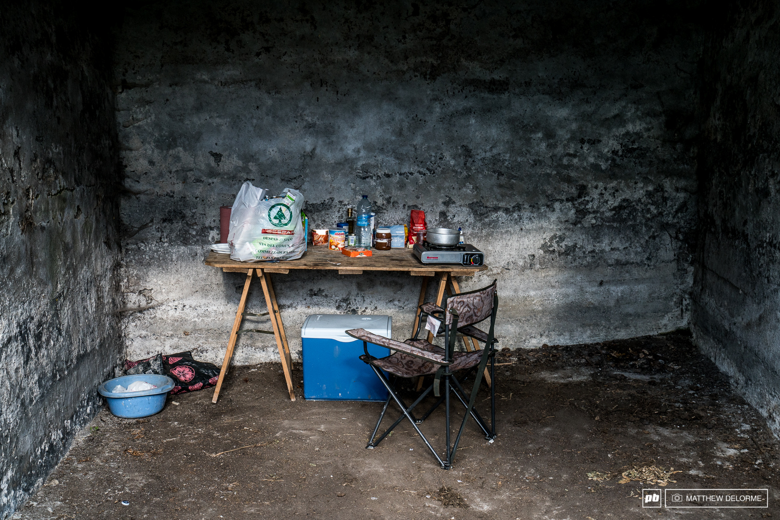 World Cup racing isn t all glamour. This kitchen setup in a rustic open basement is all you need to keep warm and nourished though.