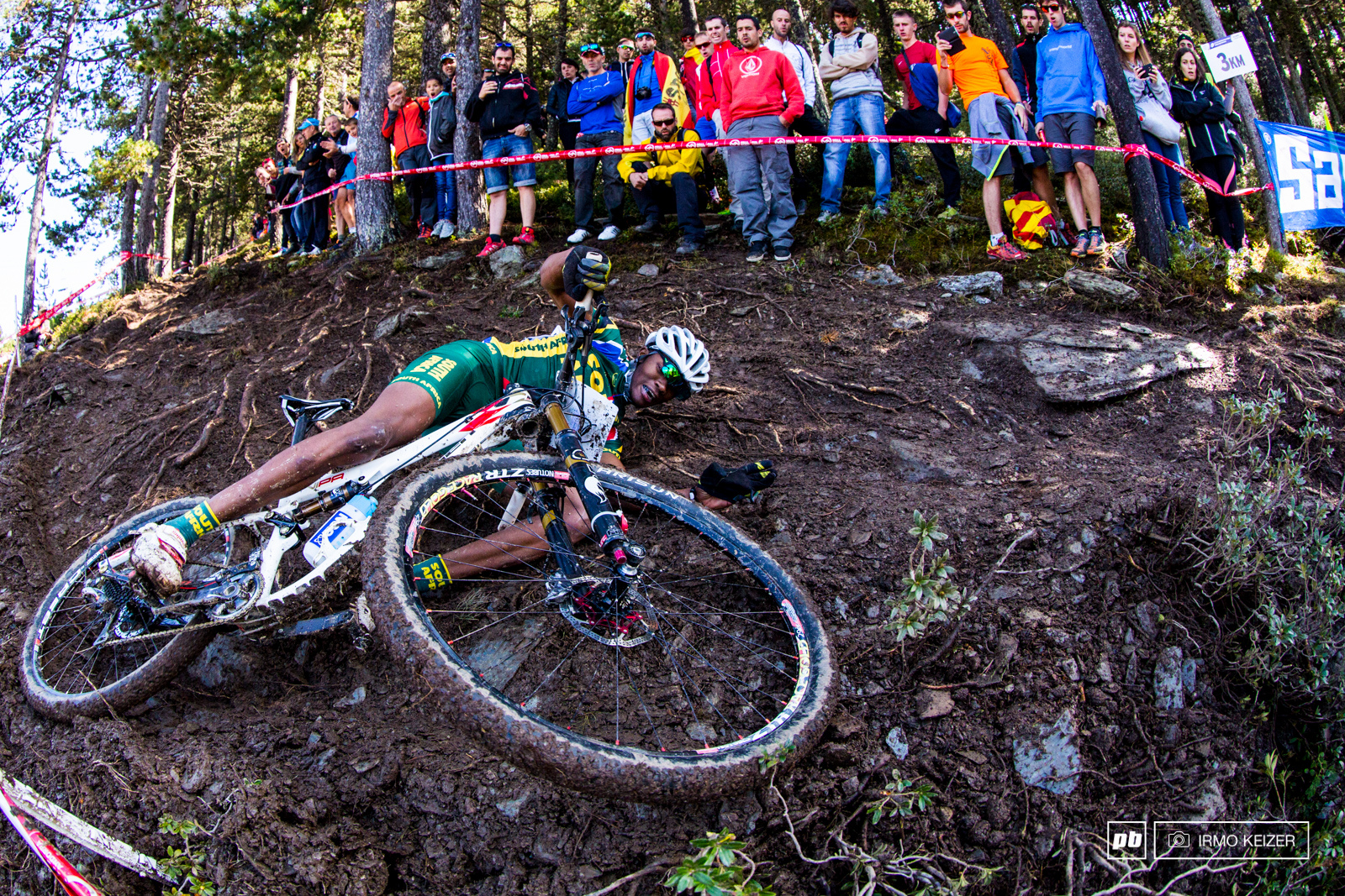 One of many to slide out South African William Mokgopo takes a tumble on one of the trickiest part of the course.