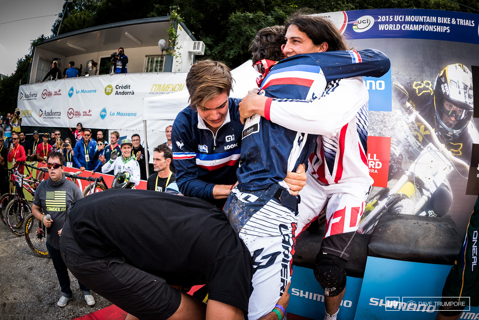 Ratboy gives Loic a hug as Cedric Gracia attempts to lift him up on his shoulders.