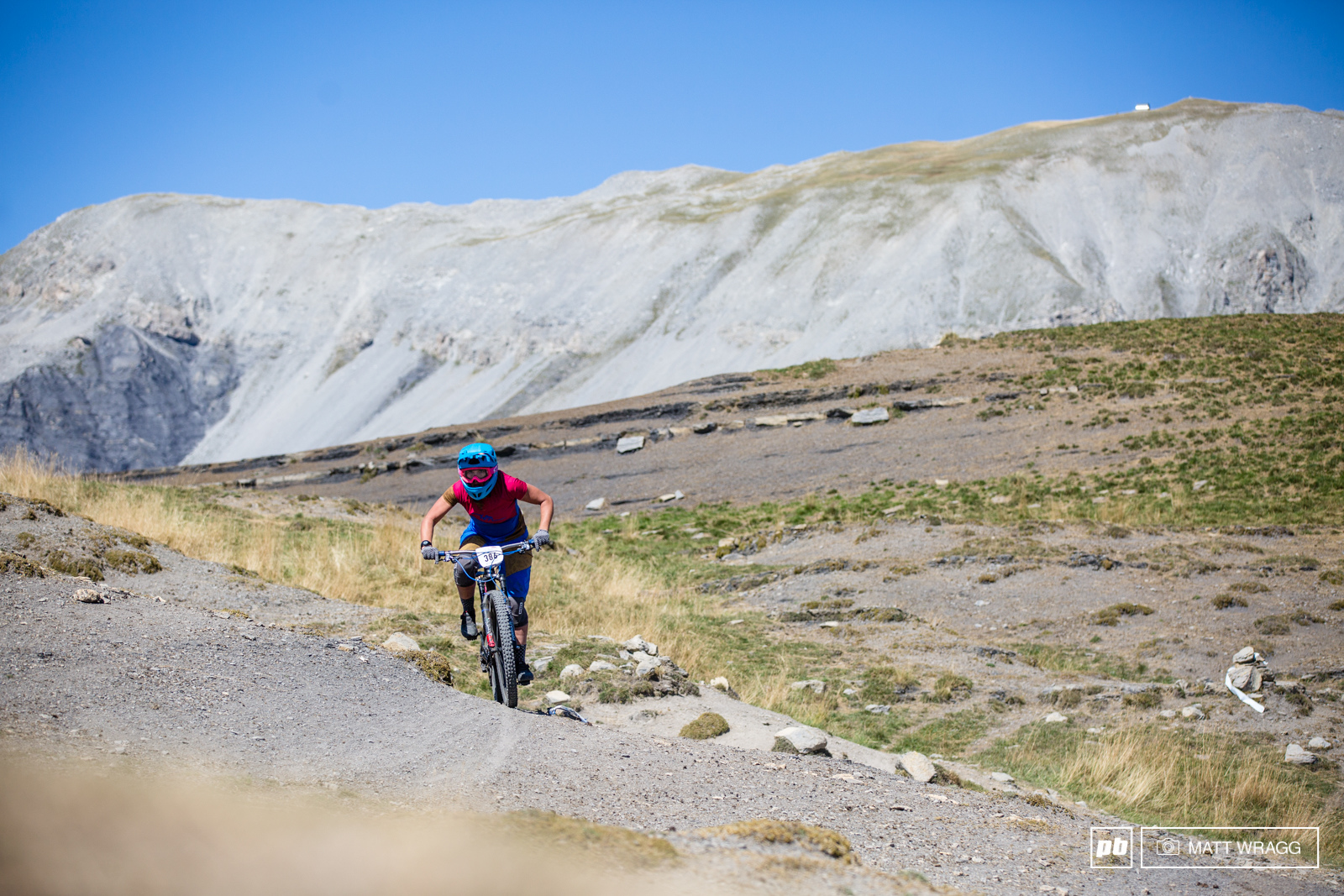 On the other side of the mountain the wind has blown away the grass and riders dropped into a barren lunar landscape.