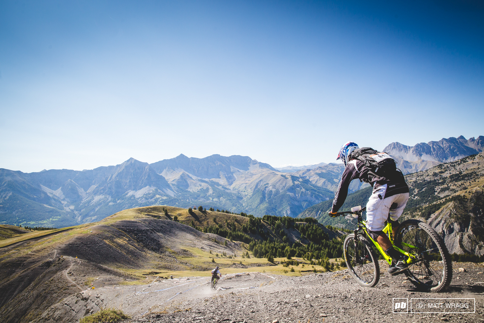 This high up and far out from the world the grey loose earth is unforgiving terrain for racing.