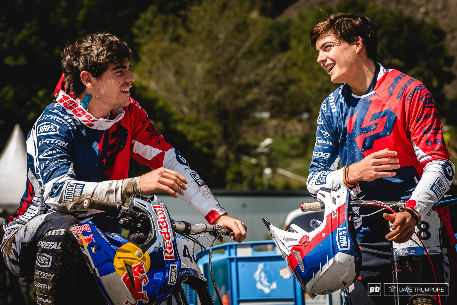 Loic and Loris trading battle stores after a muddy training session in Andorra.