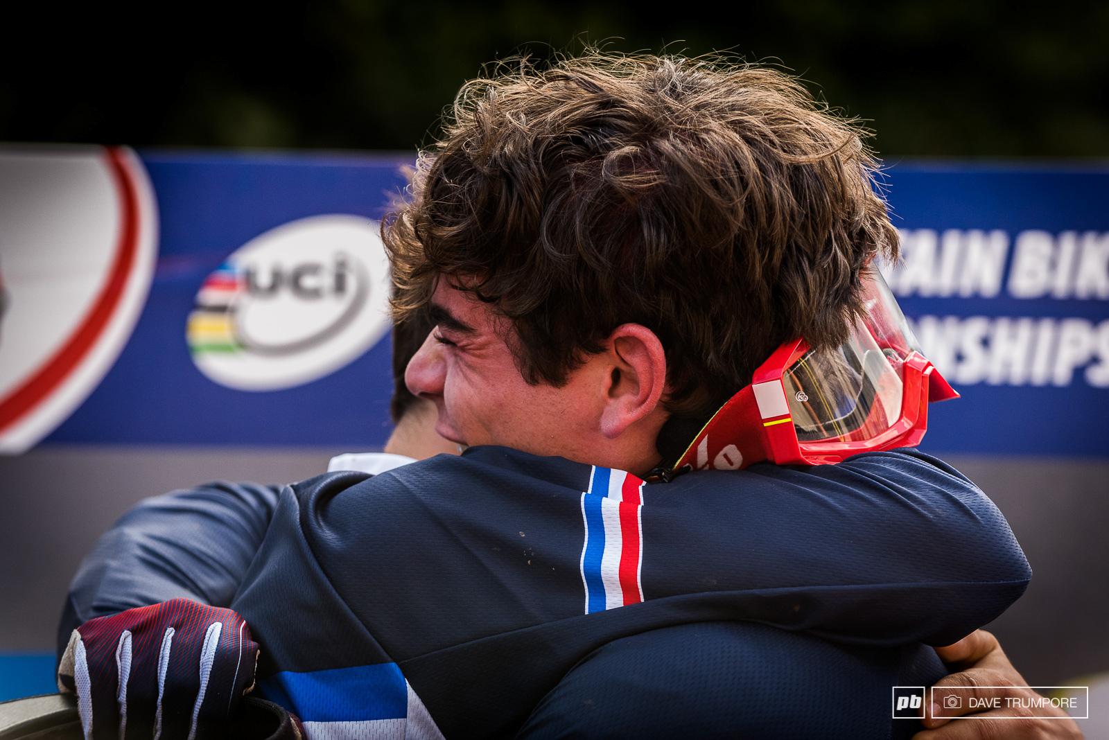 Loic Bruni and teammate Loris Vergier celebrate victory in Andorra.