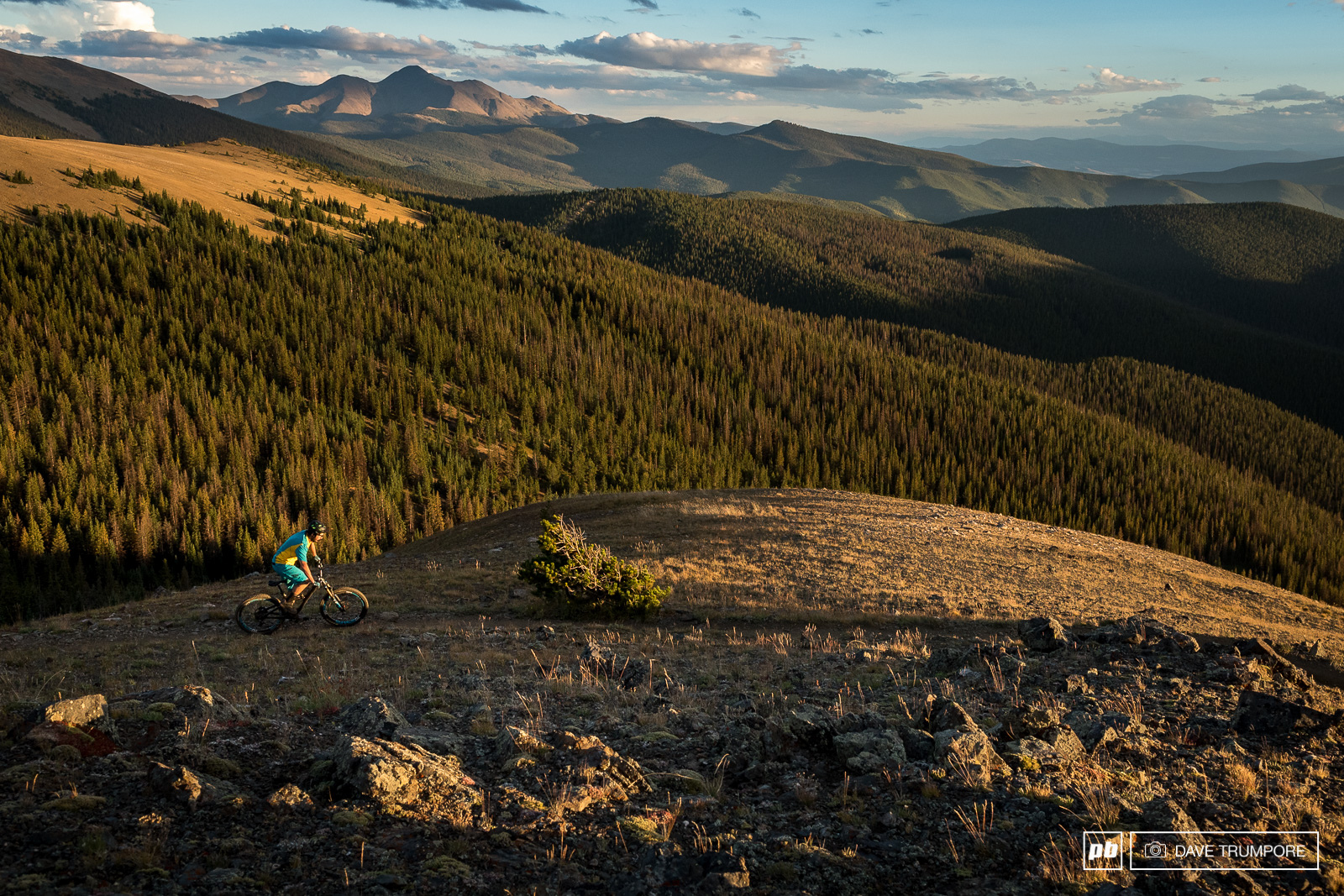 Shawn Neer crests the top of the climb and enjoys the warm but brief ray of sunshine.