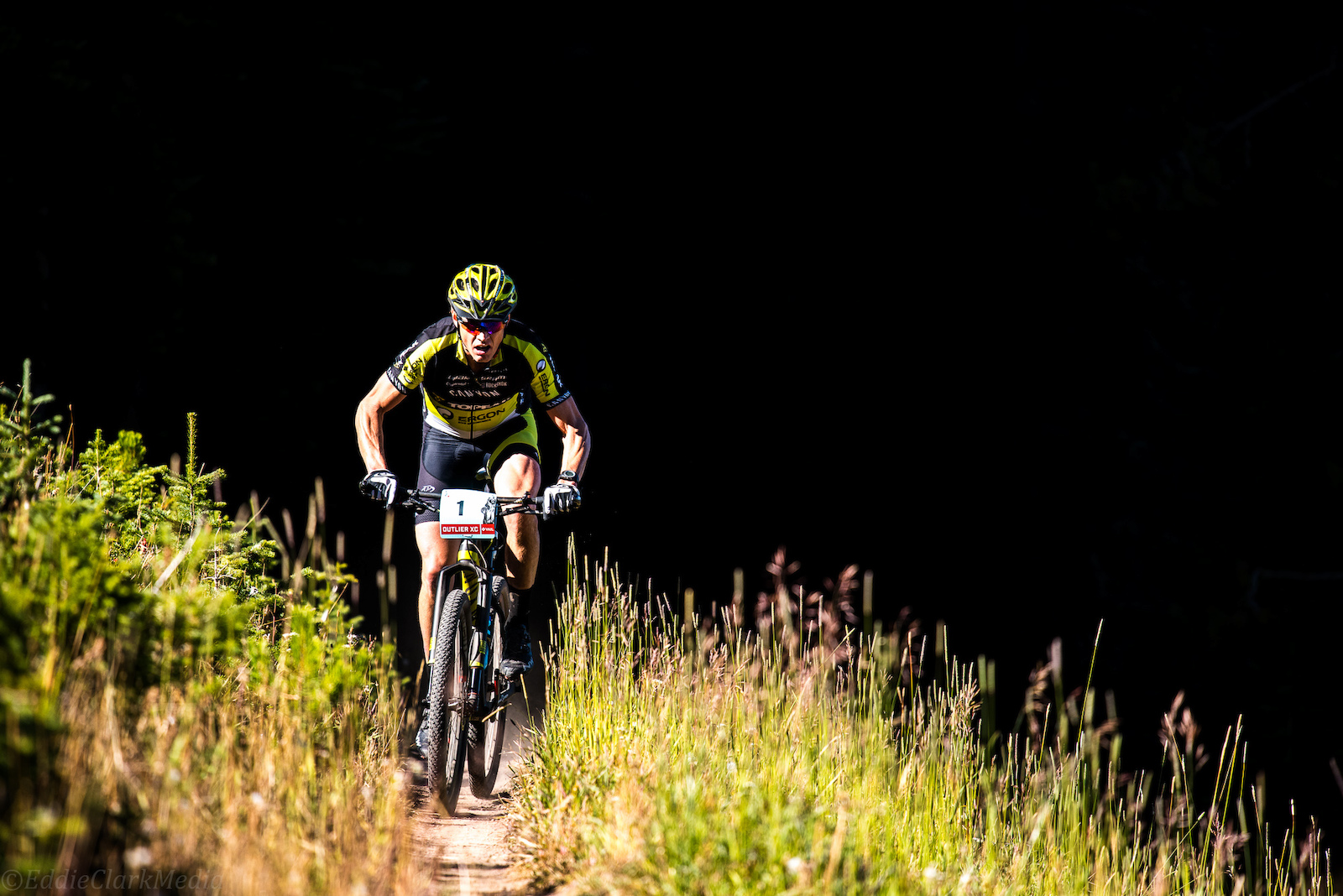 Rocky Mtn legend Dave Wiens rides out of the darkness during the Vail Outlier Offroad XC race.