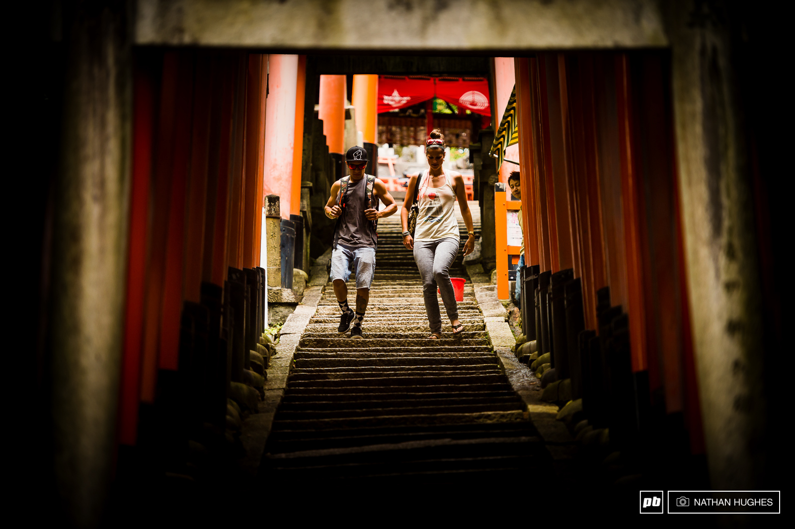 Walking the trail of thousands of orange arches at Kyoto s Fushimi shrine.