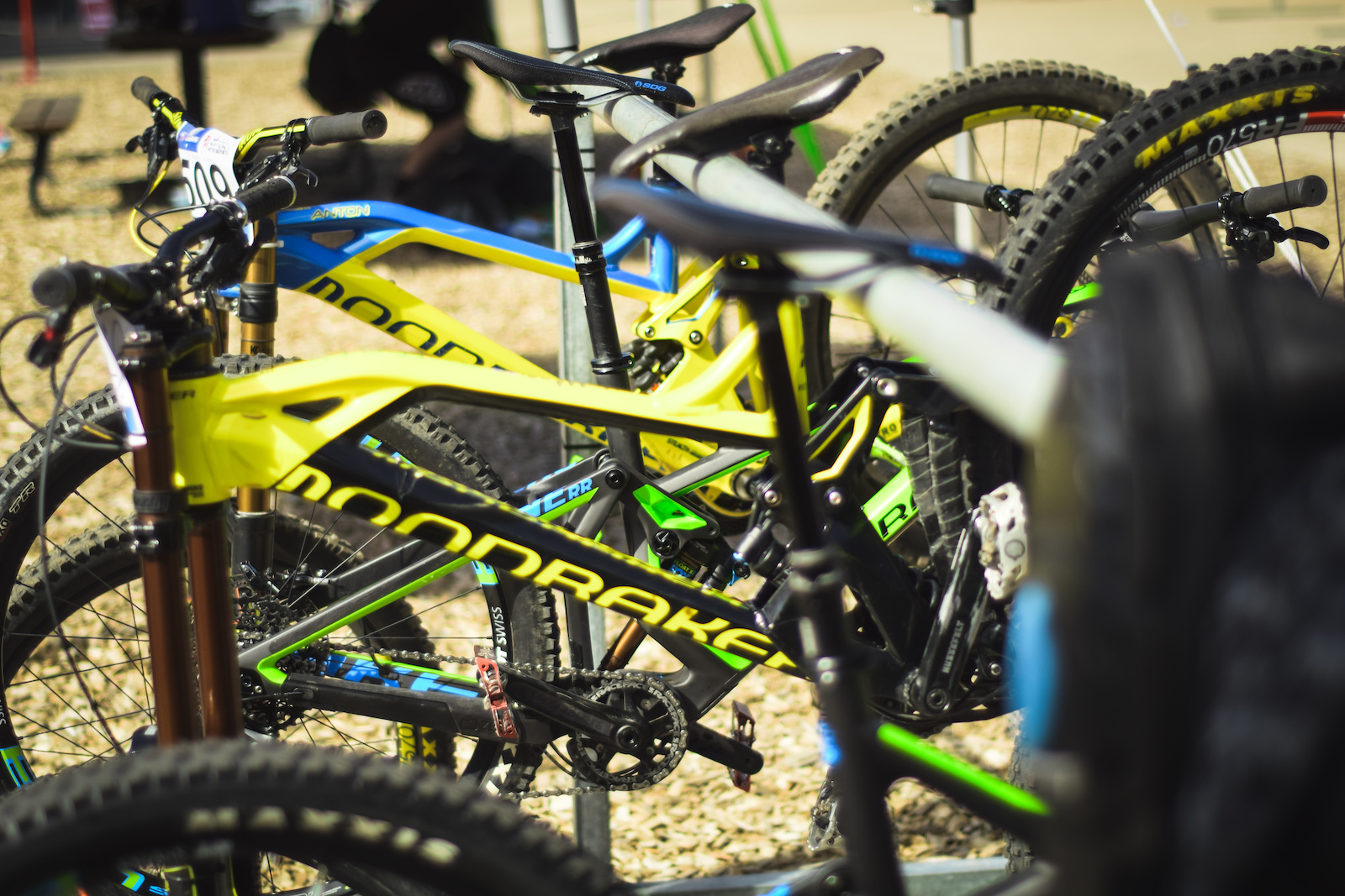 Countless Mondraker Summum s hanging on a ski rack in the pits