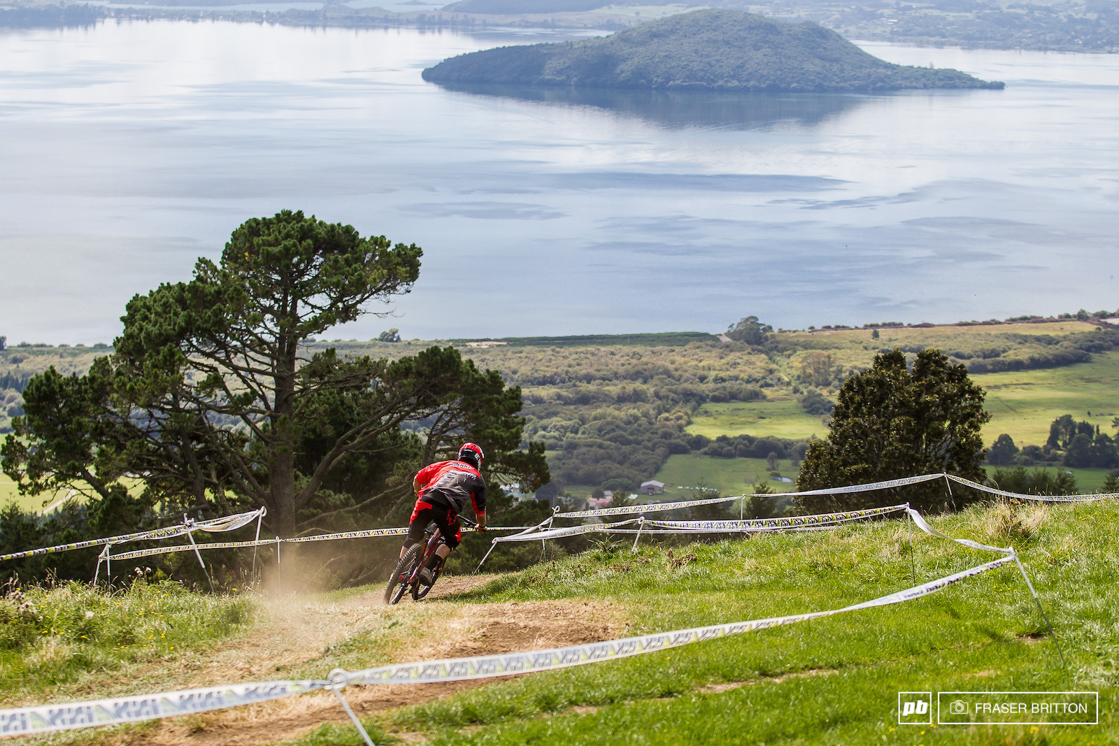Coming into the day local Kiwi Sam Blenkinsop was among the favourites for the win. Getting loose is what Blenki does and he was hanging it out all over the place. With his Grandmother and Mom in attendance he was out to show what he s got. Here he drops into the top of the track with lake Rotorua in the distance.