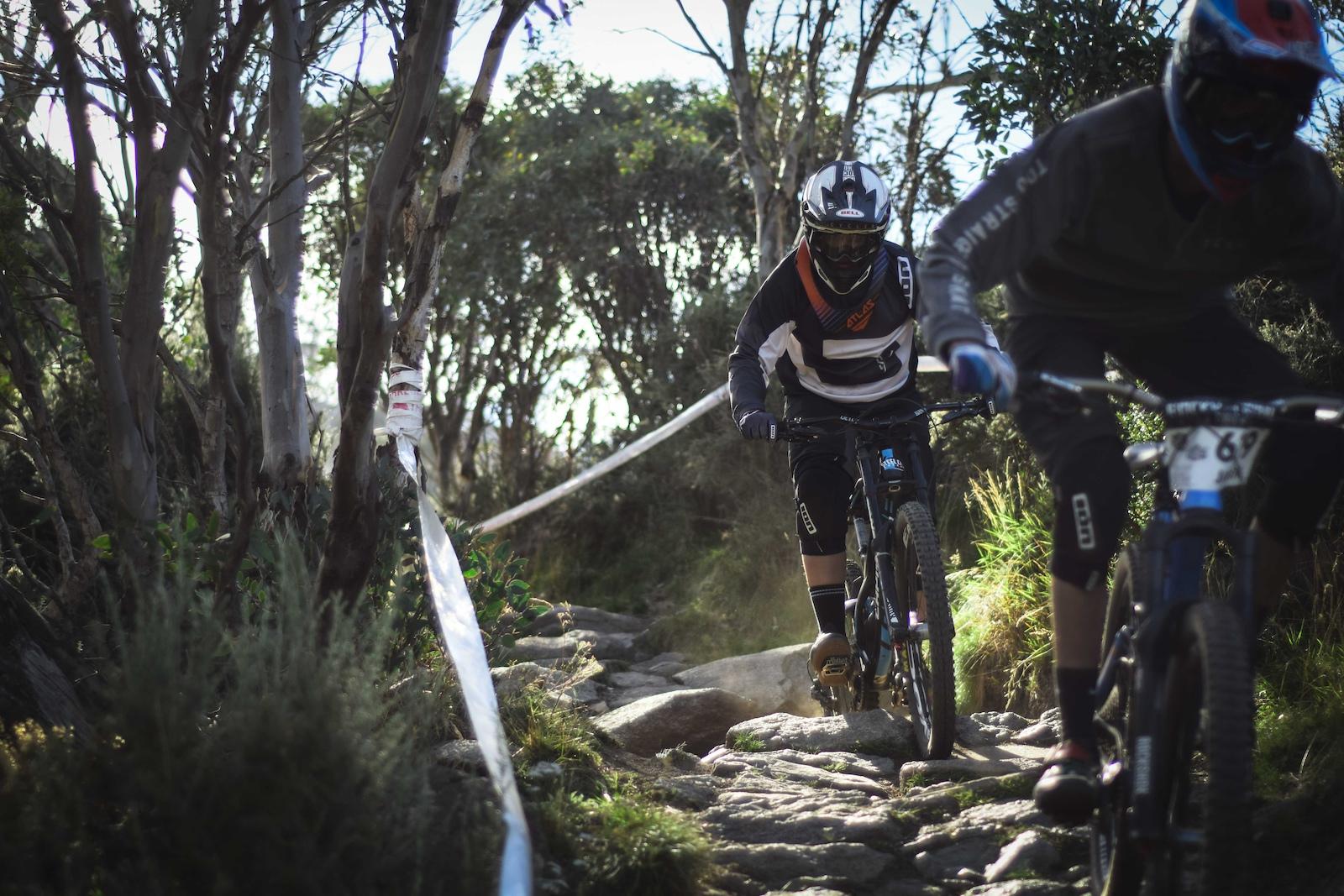 Enduro and downhill boys a like all had fun while tackling the terrain. Isaac Ridley hunting down Jaden Mann