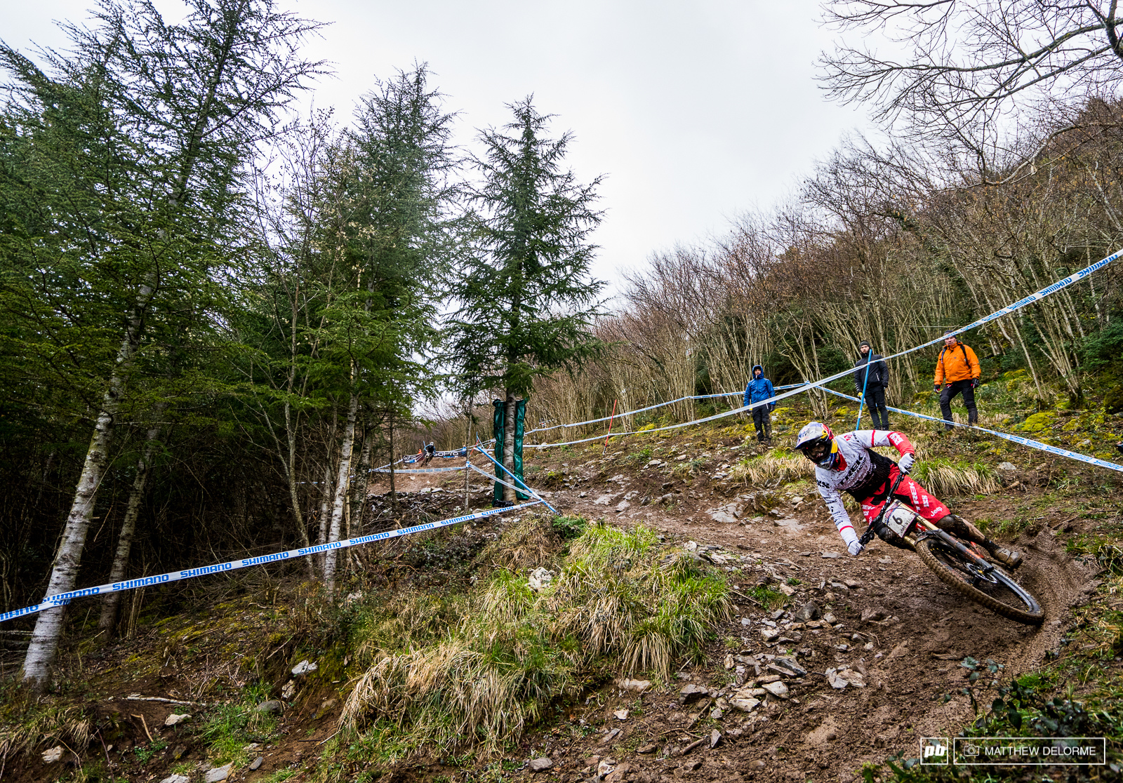 Gee Atherton slip-sliding through the slop on the last run of the day.