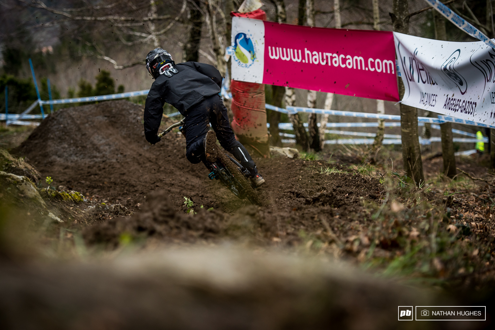 The track was running super slow and sticky making it mighty difficult to carry speed from section to section. There were big names riding a tamer than usual some almost creeping by unoticed under their blacked-out mud gear.