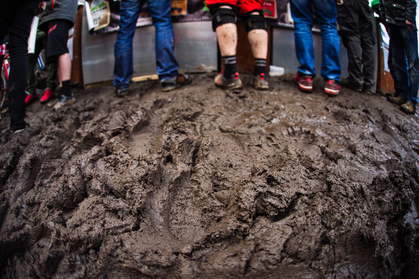With all the spectators in the bombhole trampling the wet ground into mud queuing for a beer became a slippery affair.