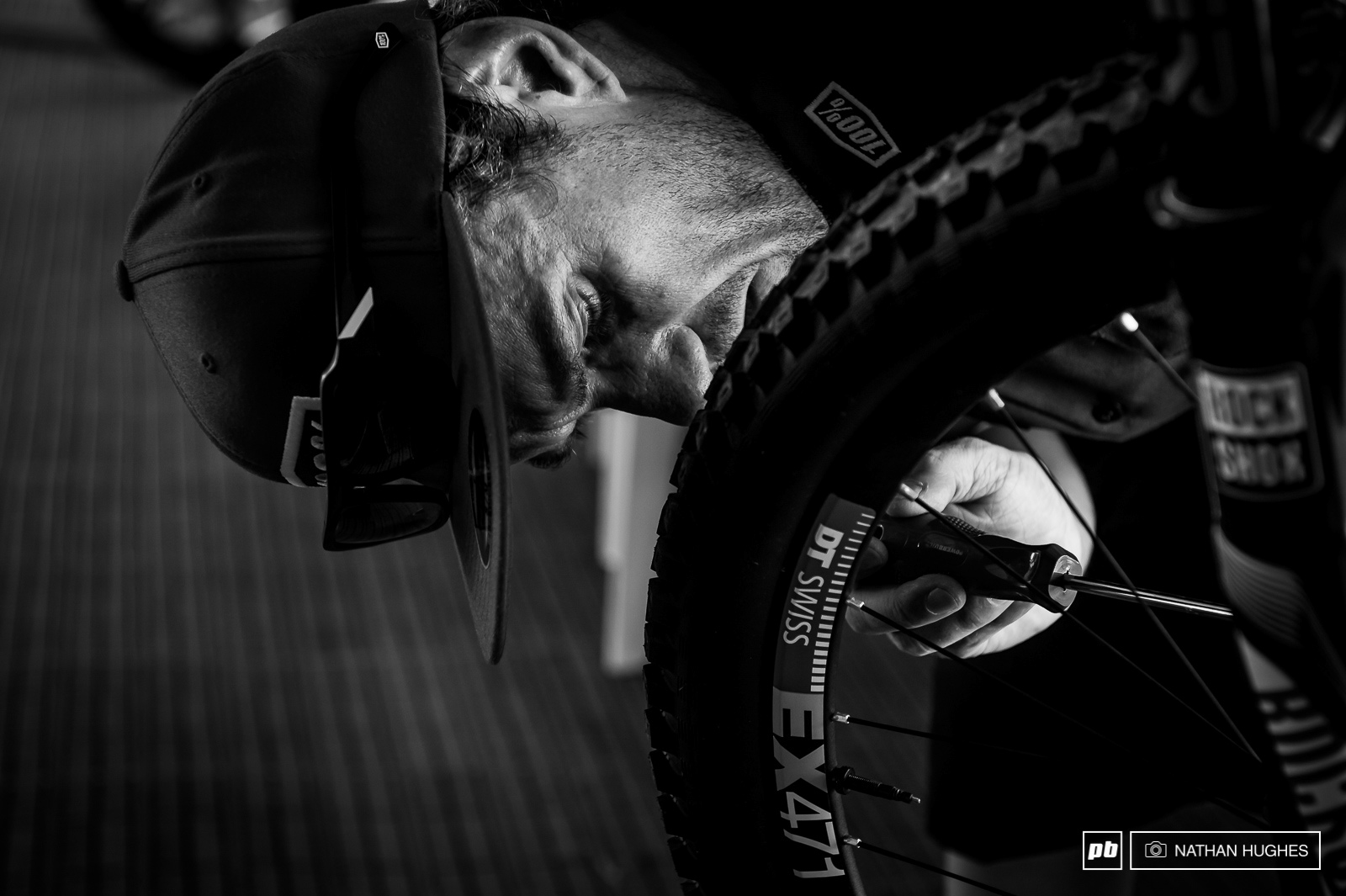 Specialized Gravity republic mechanic Jack tuning Loic s brakes. The World Champ is running bladed spokes for the high speed track.